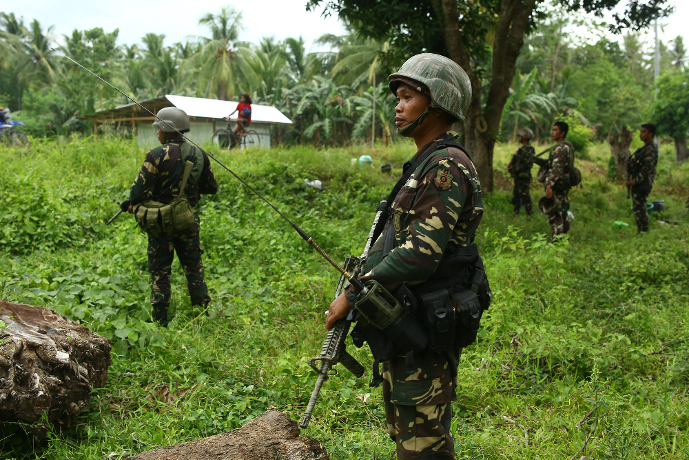 Philippine soldiers patrol a village near a highway in southern Maguindanao province, amid attacks by the Bangsamoro Islamic Freedom Fighters, a pro-Islamic State militant group, May 10, 2017. (Photo: AFP)