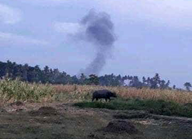 A plume of smoke is seen in the wake of a military artillery assault against suspected pro-Islamic State militants in Shariff Saydona Mustapha town in Maguindanao province, March 13, 2019. [HO/Philippine Army]