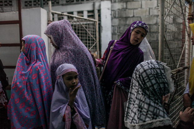 Muslim women and girls gather outside a small mosque during Eid celebrations in Marikina, Philippines, Aug. 11, 2019. [Basilio Sepe/BenarNews]