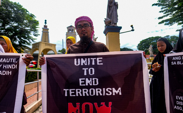 Muslims in the northern Philippine province of Pangasinan demonstrate in front of the Our Lady of Manaoag Church in Manaoag to denounce the Islamic State terror group, Aug. 11, 2019. [Jojo Rinoza/BenarNews]