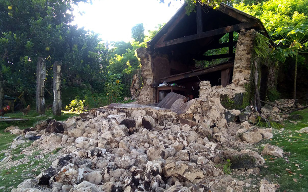 A home with walls made of stones and concrete collapsed after an earthquake with strong aftershocks hit the Philippines' northernmost province of Batanes, July 27, 2019.