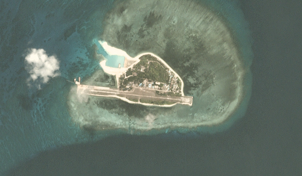 This satellite image shows Thitu Island as of May 22, 2020. The runway has been fortified and the nearly completed beaching ramp is visible in the upper left. [PhotoLabs INC]