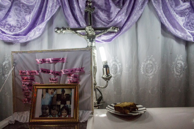 Photos of Myca Ulpina, a 3-year-old Filipina who was killed by gunfire during a police counter-narcotics operation, are seen during her wake in Rizal province, Philippines, July 5, 2019. [Basilio Sepe/BenarNews]