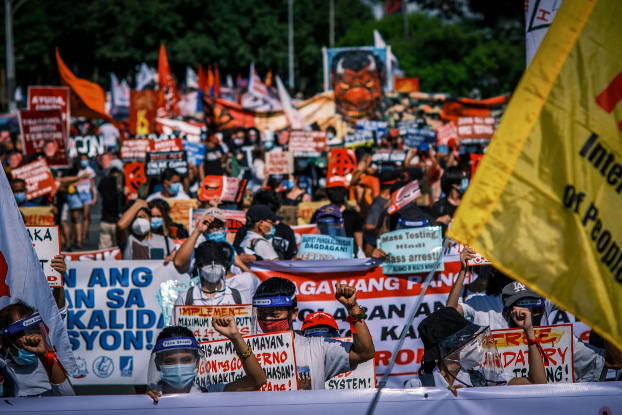 Protesters rally at the University of the Philippines in Manila to denounce policies by President Rodrigo Duterte, July 27, 2020. [Luis Liwanag/BenarNews]