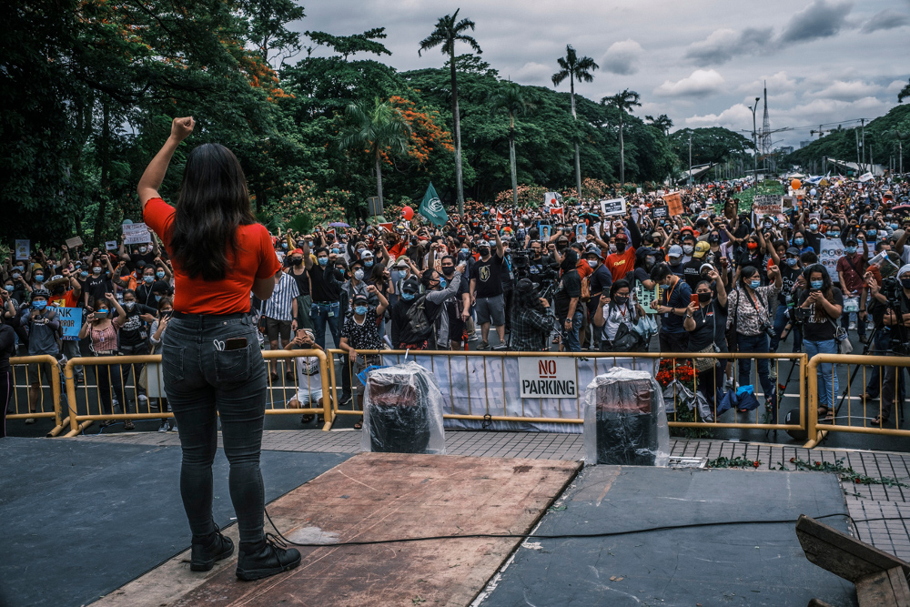 An activist addresses a rally against anti-terror legislation in Manila, June 12, 2020. [Luis Liwanag/BenarNews]
