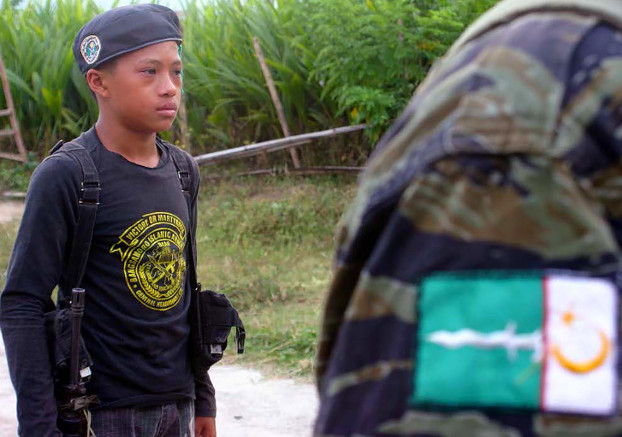 A boy stands at attention at the remote Moro National Liberation Camp in Jolo, May 29, 2016. [Mark Navales/BenarNews]
