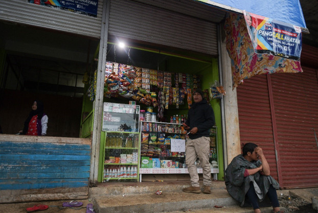 A store owned by an internally displaced person is lit by solar power in Tolali village in Marawi, Philippines, July 16, 2020.