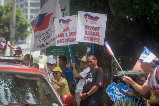 Filipino activists protest outside the building housing the Chinese Embassy in Manila, July 12, 2019. (Luis Liwanag/BenarNews)