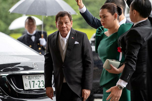 Philippine President Rodrigo Duterte (left) and his daughter, Sara, arrive to attend the enthronement ceremony of Japan's Emperor Naruhito in Tokyo, Oct. 22, 2019.