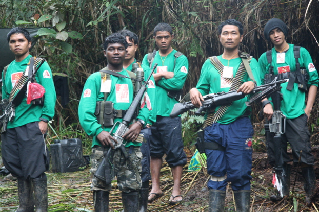 New People's Army guerrillas gather at an undisclosed camp somewhere in the southern Philippine island of Mindanao in 2011. (Dennis Jay Santos/BenarNews)