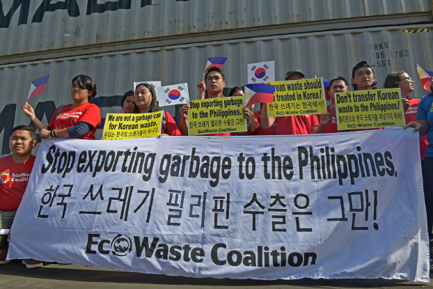 Activists with the Ecowaste Coalition, an environmental group, stage a rally in front of container vans loaded with household waste at the Mindanao Container Terminal in Tagoloan, Misamis Oriential province, southern Philippines, Jan. 13, 2019. (Froilan Gallardo/BenarNews)