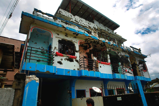 Two units of this four-story house in the southern Philippine city of Marawi were rented by Isnilon Hapilon, the acknowledged leader of the Islamic State in Southeast Asia, Oct. 30, 2017. (Mark Navales/BenarNews)