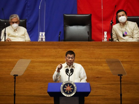 Philippine President Rodrigo Duterte delivers his sixth State of the Nation Address as Senate President Vicente Sotto III (left) and House Speaker Lord Allan Velasco listen, at the House chamber in Metro Manila, July 26, 2021.