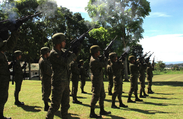 A Philippine Army platoon renders a gun salute as a sign of respect during the wreath-laying ceremony at the heroes' landmark inside the 103rd Infantry Brigade headquarters in Marawi, Oct. 17, 2019. [Richel V. Umel/BenarNews]