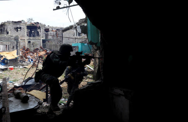 Philippine troops search for militant fighters in an area of Mapandi village near the ground-zero of fighting in the southern city of Marawi, Sept. 14, 2017.