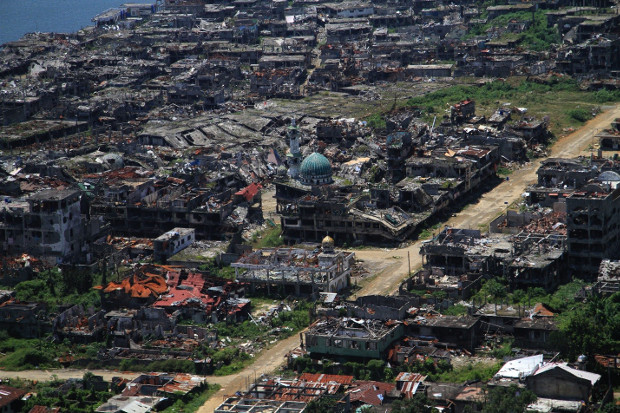 An aerial photograph shows the devastated areas of the southern Philippine city of Marawi, April 6, 2018.  [Richel V. Umel/BenarNews]