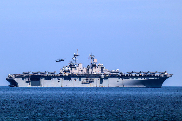 A helicopter lands on the USS Wasp during an annual joint training exercise in the western Philippine province of Zambales, April 11, 2019.  [Jay Rey/BenarNews]