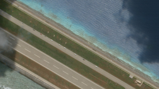 A few cars convoy at Subi Reef next to its airstrip, Aug. 27, 2020. [Planet Labs Inc.]