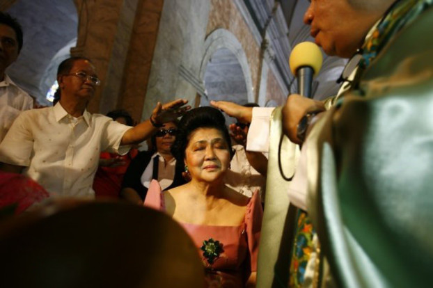 Ecumenical leaders pray over former Philippine first lady Imelda Marcos at a church in Manila's Tondo district, in this undated file photo. [Luis Liwanag/BenarNews]