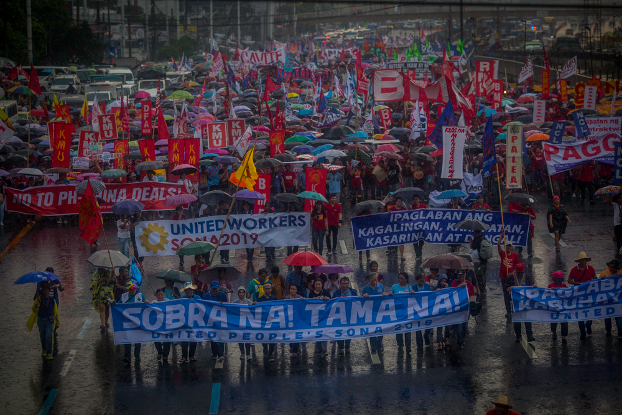 Thousands braved heavy rain to protest on the streets of Manila as President Rodrigo Duterte delivered his annual state of the nation address to congress, July 22, 2019. [Luis Liwanag/BenarNews]