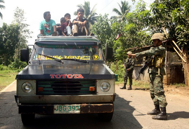Soldiers stop a vehicle at a military checkpoint in Jolo, Sulu, in the southern Philippines, Sept. 25, 2014.