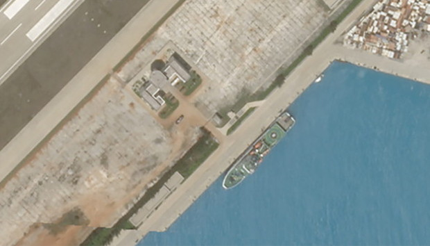 A closer-cropped view of the Feb. 23 satellite image of Fiery Cross Reef showing what appears to be Chinese rescue vessel Nan Hai Jiu 115, which ship-tracking software shows was at that location on the same day. [Planet Labs Inc.]