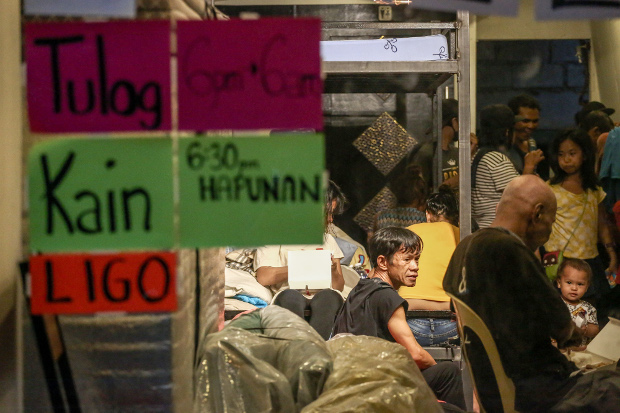 A restaurant in Quezon City, near Manila, is converted into an emergency shelter at night to cater to Philippines capital's homeless after the government imposed a sweeping quarantine to control the spread of COVID-19, March 21, 2020. [Basilio Sepe/BenarNews]