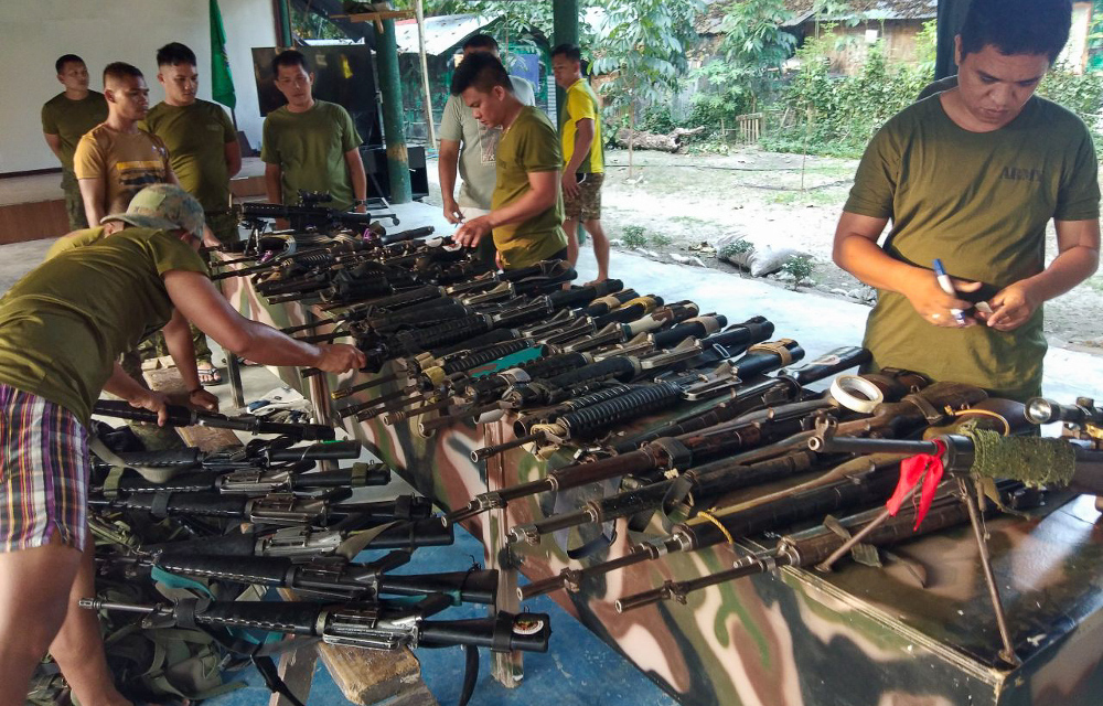 Members of the Philippines Army examine the weapons they recovered from followers of Moro National Liberation Front (MNLF) leader Nur Misuari in Buluan town, capital of the southern province of Maguindanao, Sept. 15, 2019. (Photo:  Handout/Philippine Army)