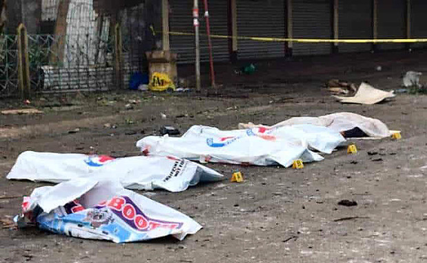 The bodies of some of the bombing victims are covered with white sheets after the two explosions in Jolo, capital of the southern Philippine province of Sulu, Jan. 27, 2019. [HO/Philippine military]