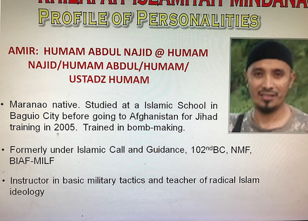 A profile and photograph of Filipino militant Abu Dar is seen in this photograph handed out to reporters by the Philippine Army, January 2018. [HO/Philippine Army]
