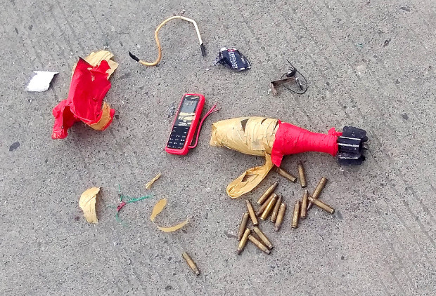 Bomb components are seen on the ground after Philippine security forces killed two suspected members of the IS-affiliated Bangsamoro Islamic Freedom Fighters in the southern Philippine town of M'lang, Aug. 8. 2018. [HO/Philippine Army 6ID]