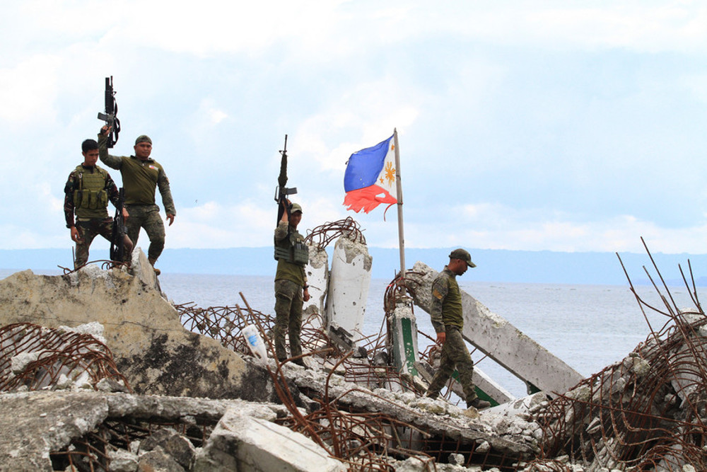 Philippine soldiers guard a section of Marawi, which was devastated by a five-month battle in 2017 with Islamic State-linked extremists who took over the southern Philippine city, April 10, 2018. (Photo: Richel V. Umel/BenarNews)