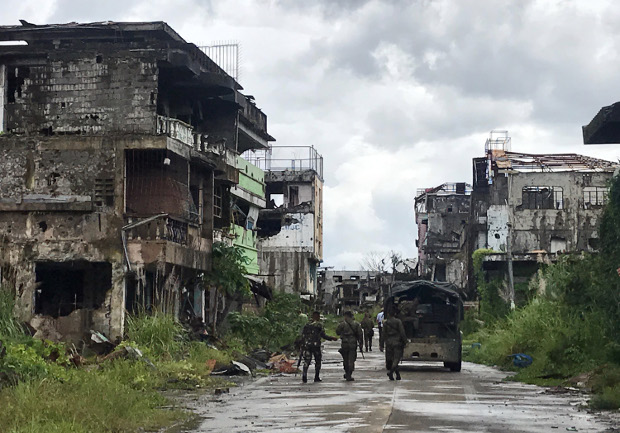 Security forces patrol the former main battle area in the southern Philippine city of Marawi, where the military engaged pro-Islamic State militants in five months of vicious clashes last year, Oct. 16, 2018.