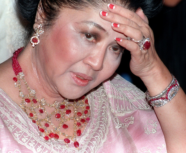 Former Philippine first lady Imelda Marcos is photographed wearing jewelry adorned with rubies and diamonds during her 70th birthday party at a luxury hotel in Manila, July 2, 1999. [AP]