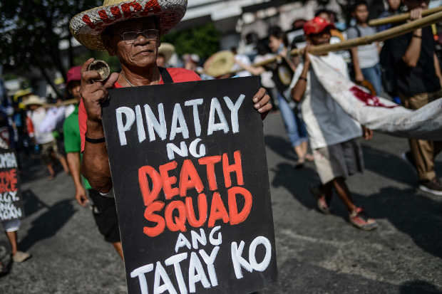 "Friends and relatives of those victimized by extrajudicial killings in the Philippine drug war join other protesters for a ""day of mourning and resistance"" in Manila, Aug. 20, 2019. [Jojo Rinoza/BenarNews]"