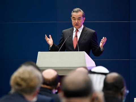 Chinese Foreign Minister Wang Yi speaks during a promotional event at the Chinese foreign ministry in Beijing, April 12, 2021.