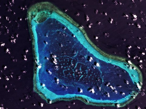 A satellite image from March 2021 shows Scarborough Shoal, one of the features trademarked by the Chinese government.