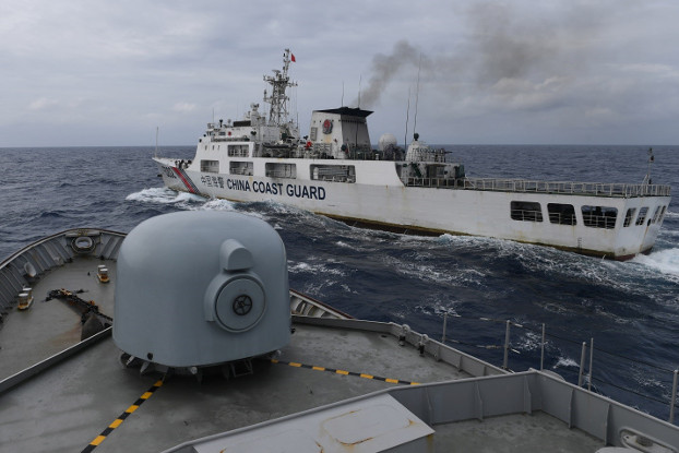 A Chinese Coast Guard ship is seen from an Indonesian Naval ship during a patrol in Indonesia's Exclusive Economic Zone near the Natuna islands, Jan. 11, 2020. [Antara Foto via Reuters]