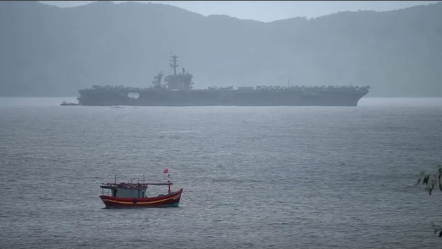 The USS Theodore Roosevelt is seen during a port call in Danang, Vietnam, marking 25 years in the normalization of US-Vietnamese diplomatic relations, March 5, 2020. [Screengrab from Reuters video]