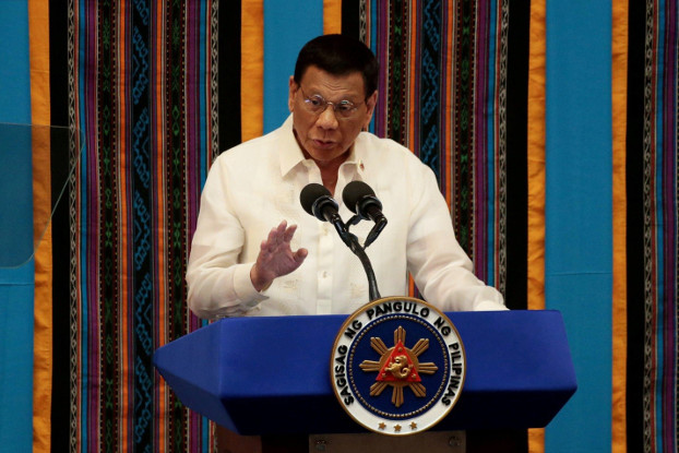 Philippine President Rodrigo Duterte gestures during his fourth State of the Nation Address at the Philippine Congress in Quezon City, Metro Manila, Philippines July 22, 2019. [Reuters]