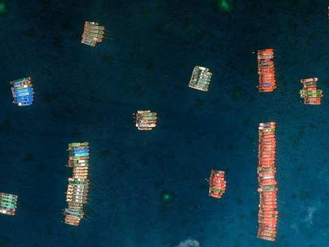 Chinese ships are seen around Whitsun Reef in the South China Sea, in this image provided by Maxar Technologies, March 23, 2021.