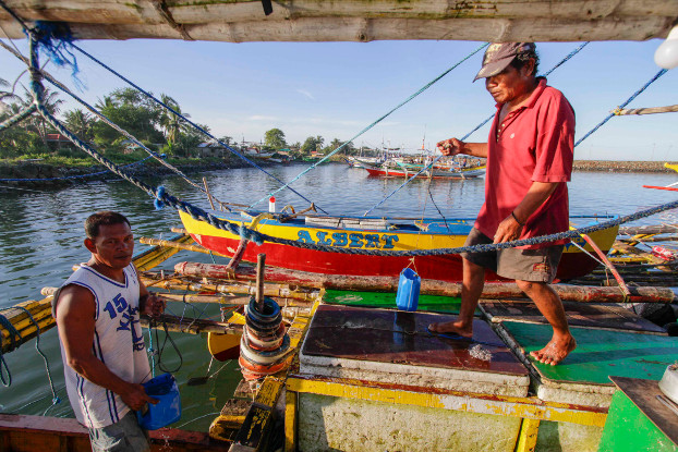 A fishing boat crew prepares for another trip to the disputed Scarborough Shoal, west of Luzon, the Philippines, in October 2016. (Karl Romano/BenarNews)