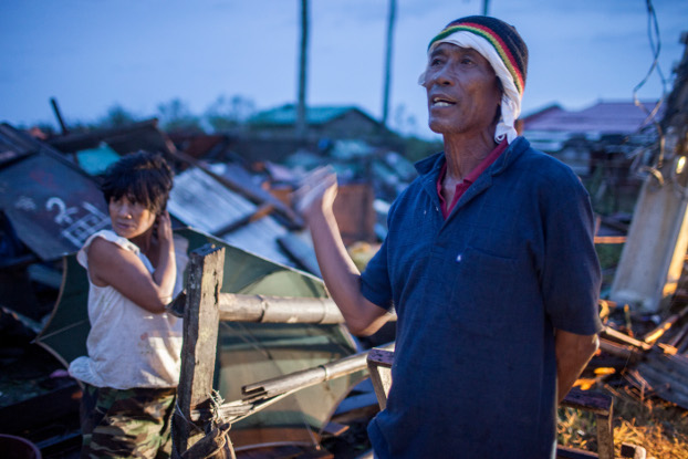 Jimmy and Anita Mirafuente react to seeing their home destroyed by Typhoon Mangkhut in Aparri province, Sept. 16, 2018. (Luis Liwanag/BenarNews)