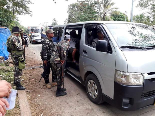 Philippine soldiers check a van in Lamitan city, Aug. 2, 2018. [Mark Navales/BenarNews]