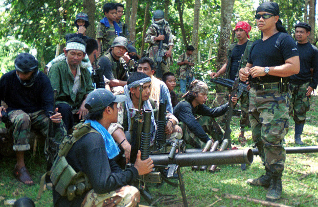 A group of armed Filipino Abu Sayyaf Group militants gather in this undated photo. [AP]
