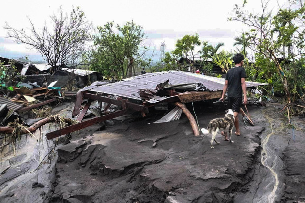 A resident wanders around houses destroyed by flashfloods due to Typhoon Goni in Albay province, southeast of Manila, Nov. 1, 2020. (BenarNews)