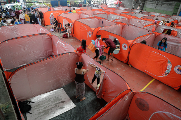 Residents occupy an evacuation center as rains from a typhoon locally known as Rolly start to pour in Manila, Philippines, Sunday, Nov. 1, 2020 (AP)