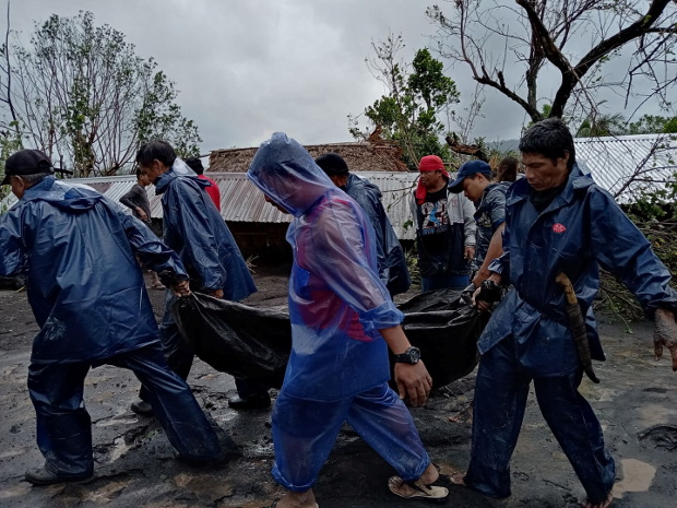 People carry the body of a victim in the aftermath of Typhoon Goni in San Francisco, Guinobatan, Albay province, Philippines, Nov. 1, 2020. (Shyneth Occidental Montero/Handout Picture/Reuters)