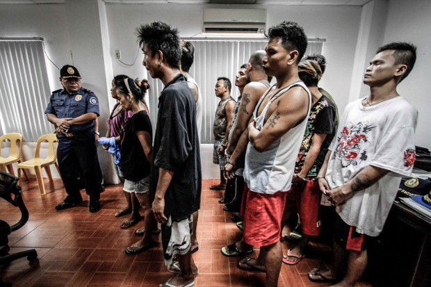 A group of suspected drug pushers and users is shown after they were rounded up by police in Dagupan, Philippines, in October 2016. (Karl Romano/BenarNews)