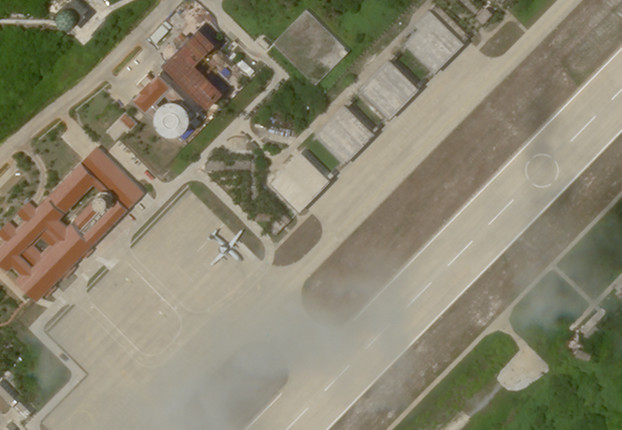 A plane that looks like a KJ-500 early warning aircraft sits on the apron of Woody Island's massive airstrip, June 27, 2020. (PlanetLabs Inc.)